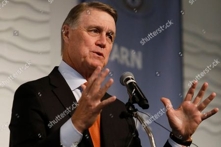 Sen. David Perdue, R-Ga., speaks during a Kiwanis Club of Atlanta luncheon