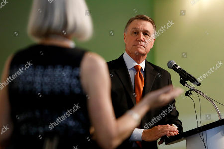 Kathy Colbenson asks Sen. David Perdue, R-Ga., about addressing gun violence in the U.S. during a Kiwanis Club of Atlanta luncheon