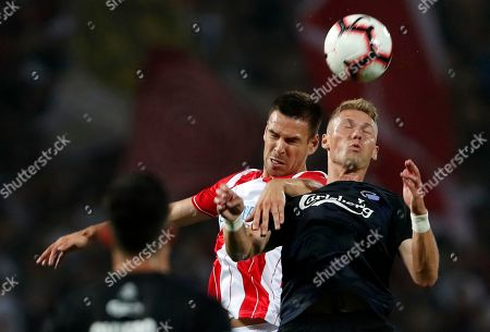 Copenhagen's Viktor Fischer, right, jumps for the ball with Red Star's Marko Gobeljic during the Champions League third qualifying round, first leg soccer match between Red Star and FC Copenhagen on the stadium Rajko Mitic in Belgrade, Serbia
