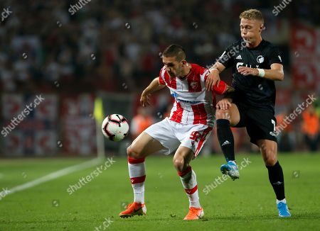 Red Star's Aleksa Vukanovic, left, duels for the ball with Copenhagen's Viktor Fischer during the Champions League third qualifying round, first leg soccer match between Red Star and FC Copenhagen on the stadium Rajko Mitic in Belgrade, Serbia