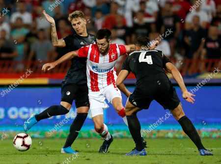 Red Star's Mirko Ivanic, center, duels for the ball with Copenhagen's Guillermo Varela, left, and Copenhagen's Sotirios Papagiannopoulos during the Champions League third qualifying round, first leg soccer match between Red Star and FC Copenhagen on the stadium Rajko Mitic in Belgrade, Serbia