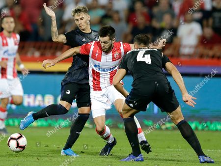 Red Star?s Mirko Ivanic (C) in action against Copenhagen?s Sotirios Papagiannopoulos (R) and Guillermo Varela (L)  during the UEFA Champions League third qualifying round first leg soccer match between Red Star Belgrade and FC Copenhagen in Belgrade, Serbia, 06 August 2019.