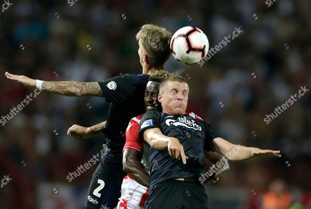 Copenhagen?s Pep Biel Mas Jaume (R) and Guillermo Varela (L) in action against Red Star?s Richmond Boakye (C) during the UEFA Champions League third qualifying round first leg soccer match between Red Star Belgrade and FC Copenhagen in Belgrade, Serbia, 06 August 2019.