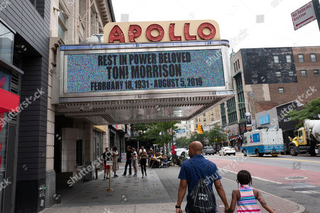 """The marquee of the Apollo Theater honors Toni Morrison, in New York. Nobel laureate Morrison, a pioneer and reigning giant of modern literature whose imaginative power in """"Beloved,"""" ''Song of Solomon"""" and other works transformed American letters by dramatizing the pursuit of freedom within the boundaries of race, has died at age 88"""