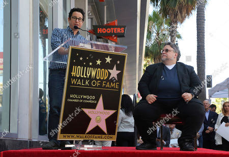 J.J. Abrams, Guillermo del Toro. J.J. Abrams, left, speaks as Guillermo del Toro listens during a ceremony honoring del Toro with a star at the Hollywood Walk of Fame, in Los Angeles