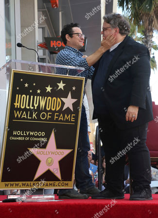 J.J. Abrams, Guillermo del Toro. J.J. Abrams, left, and Guillermo del Toro hug during a ceremony honoring del Toro with a star at the Hollywood Walk of Fame, in Los Angeles