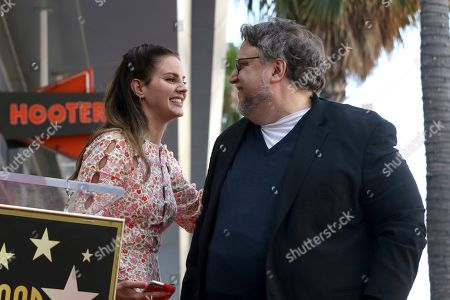 Lana Del Rey, Guillermo del Toro. Lana Del Rey, left, and Guillermo del Toro smile at each other during a ceremony honoring del Toro with a star at the Hollywood Walk of Fame, in Los Angeles