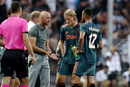 Ajax coach Erik ten Hag (2-L), Kasper Dolberg (2-R) of Ajax and Noussair Mazraoui (R) of Ajax  during the UEFA Champions League third qualifying round first leg soccer match between PAOK FC and Ajax in Thessaloniki, northern Greece, 06 August 2019.
