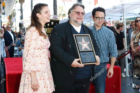 Stock Photo of Lana Del Rey, Mexican filmmaker Guillermo Del Toro and US director JJ Abrams during a ceremony honoring Del Toro with the 2669th star on the Hollywood Walk of Fame in Los Angeles, California, USA 06 August 2019. His star is dedicated in the Category of Motion Pictures.