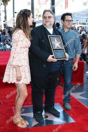 Stock Picture of Lana Del Rey, Mexican filmmaker Guillermo Del Toro and US director JJ Abrams during a ceremony honoring Del Toro with the 2669th star on the Hollywood Walk of Fame in Los Angeles, California, USA 06 August 2019. His star is dedicated in the Category of Motion Pictures.