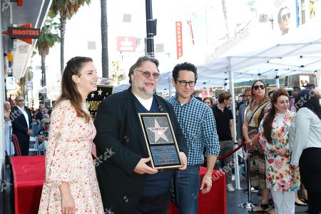 Stock Image of Lana Del Rey, Mexican filmmaker Guillermo Del Toro and US director JJ Abrams during a ceremony honoring Del Toro with the 2669th star on the Hollywood Walk of Fame in Los Angeles, California, USA 06 August 2019. His star is dedicated in the Category of Motion Pictures.