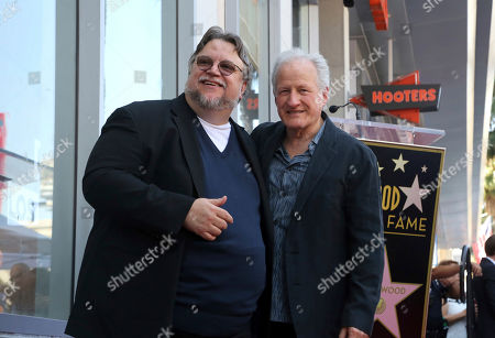 Guillermo del Toro, Michael Mann. Guillermo del Toro, left, and Michael Mann pose following a ceremony honoring Guillermo del Toro with a star at the Hollywood Walk of Fame, in Los Angeles