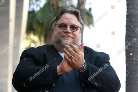 Guillermo del Toro applauds during a ceremony honoring him with a star at the Hollywood Walk of Fame, in Los Angeles