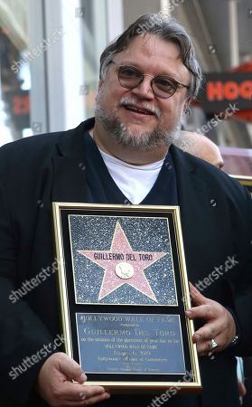 Guillermo del Toro holds a star miniaturette during a ceremony honoring him with a star at the Hollywood Walk of Fame, in Los Angeles