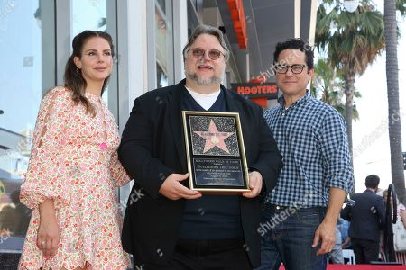 Lana Del Rey, Guillermo del Toro, J.J. Abrams. Lana Del Rey, left, Guillermo del Toro and J.J. Abrams pose as Guillermo del Toro holds a star miniaturette following a ceremony honoring Guillermo del Toro with a star at the Hollywood Walk of Fame, in Los Angeles