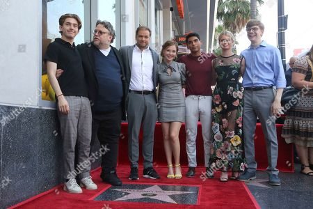 """Guillermo del Toro, Andre Øvredal. Guillermo del Toro, second from left, Andre Øvredal and members of the cast of """"Scary Stories to Tell in the Dark"""" pose atop a star following a ceremony honoring Guillermo del Toro with a star at the Hollywood Walk of Fame, in Los Angeles"""