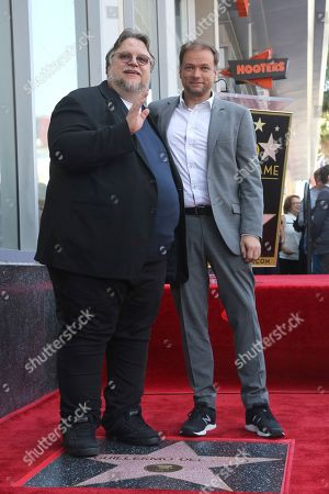 Guillermo del Toro, Andre Øvredal. Guillermo del Toro, left, and Andre Øvredal pose atop a star following a ceremony honoring Guillermo del Toro with a star at the Hollywood Walk of Fame, in Los Angeles
