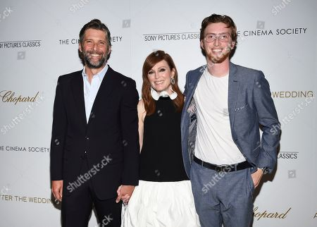 """Bart Freundlich, Julianne Moore, Caleb Freundlich. Director Bart Freundlich, left, poses with wife actor Julianne Moore and their son Caleb Freundlich at a special screening of """"After the Wedding,"""" hosted by Chopard with Sony Pictures Classics and The Cinema Society, at the Regal Essex, in New York"""