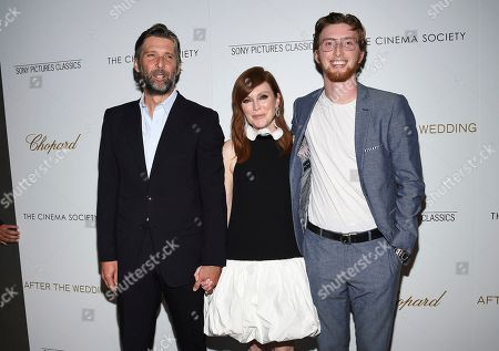 """Bart Freundlich, Julianne Moore, Caleb Freundlich. Director Bart Freundlich, left, poses with wife actor Julianne Moore and their son Caleb Freundlich at a special screening of """"After the Wedding"""", hosted by Chopard with Sony Pictures Classics and The Cinema Society, at the Regal Essex, in New York"""