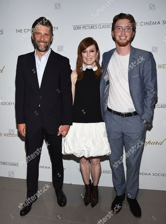 """Stock Image of Bart Freundlich, Julianne Moore, Caleb Freundlich. Director Bart Freundlich, left, poses with wife actor Julianne Moore and their son Caleb Freundlich at a special screening of """"After the Wedding"""", hosted by Chopard with Sony Pictures Classics and The Cinema Society, at the Regal Essex, in New York"""