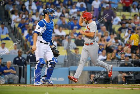 Stock Image of Paul DeJong, Matt Carpenter. St. Louis Cardinals' Paul DeJong, right, scores on a single by Matt Carpenter as Los Angeles Dodgers catcher Will Smith stands near the plate during the second inning of a baseball game, in Los Angeles