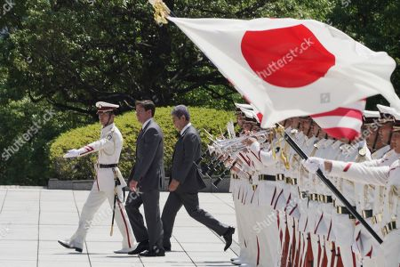 US Secretary of Defense Mark Esper (C) and Japanese Defense Minister Takeshi Iwaya (C-R) inspect an honor guard ahead of their meeting at the Ministry of Defense in Tokyo, Japan, 07 August 2019.