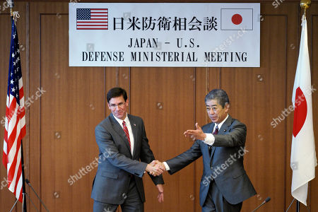 US Secretary of Defense Mark Esper (L) and Japanese Defense Minister Takeshi Iwaya (R) shake hands prior to their meeting at the Ministry of Defense in Tokyo, Japan, 07 August 2019.