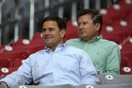 Arizona Cardinals president Michael Bidwill, right, watches practice with Arizona Gov. Doug Ducey, left, during an NFL football training camp practice at State Farm Stadium, in Glendale, Ariz
