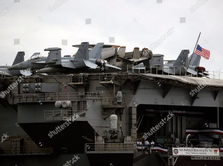 F-18 Hornet fighter jets sit at the flight deck of the US aircraft carrier 'USS Ronald Reagan' anchored at the Manila Bay, Philippines, 07 August 2019. According to news reports, the USS Ronald Reagan is in Manila for a port call after a routine deployment mission in the disputed South China Sea.
