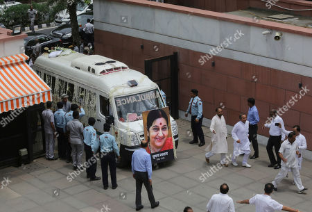 The body of former Indian Foreign Minister Sushma Swaraj is brought to the Bharatiya Janata Party headquarters in New Delhi, India, . Swaraj, a leader of the ruling Hindu nationalist Bharatiya Janata Party died at a hospital Tuesday. She was 67