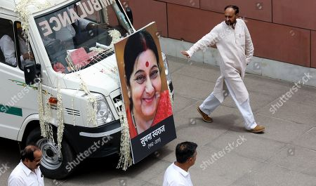 The vehicle carrying the body of former Indian External Affairs Minister and top Bharatiya Janata Party (BJP) leader Sushma Swaraj arrives at the BJP headquarters in New Delhi, India, 07 August 2019. The 67-year-old Sushma Swaraj died on 06 August after suffering a massive heart attack. Her last rites will be performed in New Delhi.