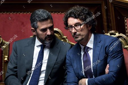 Transport and Infrastructure Minister Danilo Toninelli (R) next to Parliament Minister Riccardo Fraccaro (L), during a session in the Senate in Rome, Italy, 07 August 2019. The parliament votes on motions about the TAV Turin-Lyon high-speed rail link.
