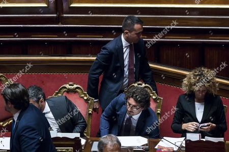 Italian Deputy Premier and Work and Economic Development Minister Luigi Di Maio (back-C) stands behind Italian Transport and Infrastructure Minister Danilo Toninelli (front-C), during a session in the Senate in Rome, Italy, 07 August 2019. The parliament votes on motions about the TAV Turin-Lyon high-speed rail link.