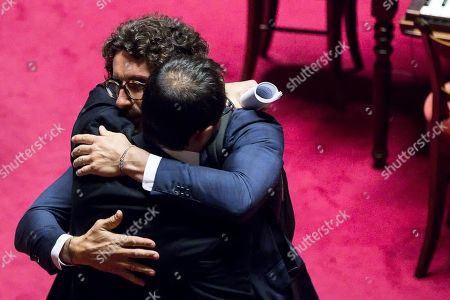 Transport and Infrastructure Minister Danilo Toninelli (L) hugs the head of the Five Star Movement (M5S) Stefano Patuanelli (R), during a session in the Senate in Rome, Italy, 07 August 2019. The parliament votes on motions about the TAV Turin-Lyon high-speed rail link.