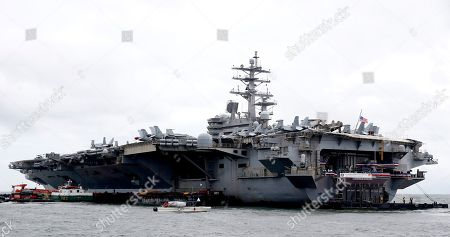 The U.S. aircraft carrier USS Ronald Reagan is anchored off Manila Bay, Philippine, for a port call . The USS Ronald Reagan is cruising in international waters in the South China Sea amid tensions in the disputed islands, shoals and reefs between China and other claimant-countries as Philippines, Vietnam and Malaysia