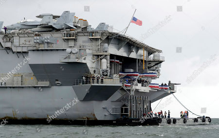 The U.S. aircraft carrier USS Ronald Reagan is anchored off Manila Bay, Philippines, for a port call . The USS Ronald Reagan is cruising in international waters in the South China Sea amid tensions in the disputed islands, shoals and reefs between China and other claimant-countries as Philippines, Vietnam and Malaysia