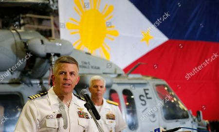 Pat Hannifin, Karl Thomas. With the Philippine flag in the background, U.S. Navy Capt. Pat Hannifin addresses the media aboard the U.S. aircraft carrier USS Ronald Reagan as it is anchored off Manila Bay, Philippines, . The USS Ronald Reagan is cruising in international waters in the South China Sea amid tensions in the disputed islands, shoals and reefs between China and other claimant-countries as Philippines, Vietnam and Malaysia. Behind him is Rear Adm. Karl Thomas, commander of the Battle Force 7th Fleet