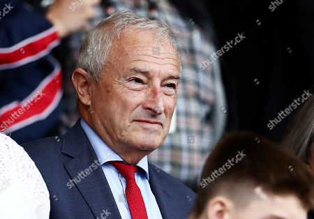 Stock Photo of Presenter Jim Rosenthal is seen in the stands.