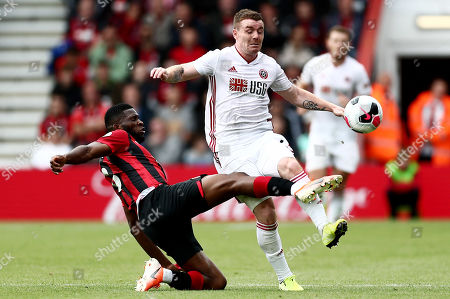 John Fleck of Sheffield United is tackled by Jefferson Lerma of Bournemouth.