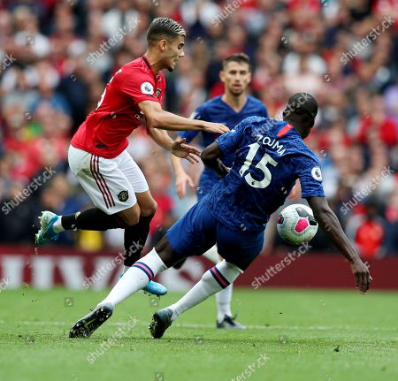 Kurt Zouma of Chelsea fouls Andreas Pereira of Manchester United for a yellow card