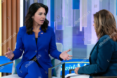 """Tulsi Gabbard, Maria Bartiromo. Presidential candidate and U.S. Representative Tulsi Gabbard (D-HI), left, is interviewed by Maria Bartiromo during her """"Mornings with Maria"""" program on the Fox Business Network, in New York"""