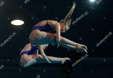 Stock Image of Phoebe Banks, Emily Martin. Britain's Phoebe Banks and Emily Martin compete on their way to win the silver medal in the 10-meter synchro platform final at the European Diving Championship in Kiev, Ukraine