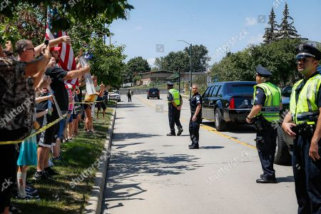 Demonstrators chant as they protest President Donald Trump's motorcade outside Miami Valley Hospital after a mass shooting that occurred in the Oregon District early Sunday morning, in Dayton. Trump headed to Dayton and El Paso, Texas on Wednesday to offer a message of healing and unity, but he will be met by unusual hostility in both places by people who fault his own incendiary words as a contributing cause to the mass shootings
