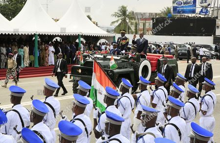 Ivory Coast President Alassane Ouattara (R) stands in an open top military vehicle during celebrations marking the 59th anniversary of Independence Day in Abidjan, Ivory Coast, 07 August 2019. Ivory Coast became independent from the French colonial rule on 07 August 1960.
