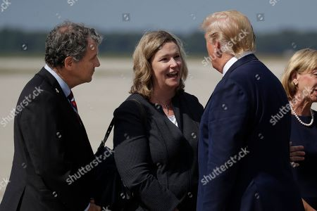Donald Trump, Nan Whaley, Sherrod Brown. President Donald Trump is greeted by Dayton Mayor Nan Whaley and Sen. Sherrod Brown, D-Ohio, after arriving at Wright-Patterson Air Force Base to meet with people affected by the mass shooting in Dayton, in Wright-Patterson Air Force Base, Ohio