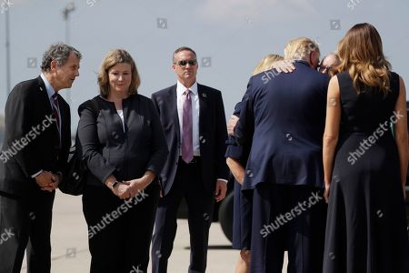 Donald Trump, Melania Trump, Nan Whaley, Sherrod Brown, Mike DeWine. Dayton Mayor Nan Whaley, center, and Sen. Sherrod Brown, left, stand in line to greet President Donald Trump and first lady Melania Trump on their arrival at Wright-Patterson Air Force Base, in Wright-Patterson Air Force Base, Ohio, as the President is greeted by Gov. Mike DeWine, R-Ohio