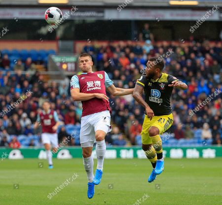 10th August 2019, Turf Moor, Burnley, England ; Premier League Football, Burnley vs Southampton : Ryan Bertrand (21) of Southampton and Johann Gudmundsson (07) of Burnley challenge for the ball  Credit: Conor Molloy/News Images English Football League images are subject to DataCo Licence