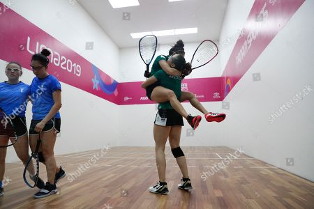Mexico's Paola Longoria jumps into the arms of her partner Samantha Salas as they defeat Guatemala's Gabriela Martinez, left, and Maria Rodriguez, in the women's racquetball team gold medal match at the Pan American Games in Lima, Peru