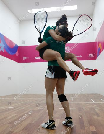 Mexico's Paola Longoria jumps into the arms of her partner Samantha Salas, after defeating Guatemala's Gabriela Martinez and Maria Rodriguez, in the women's racquetball team gold medal match at the Pan American Games in Lima, Peru