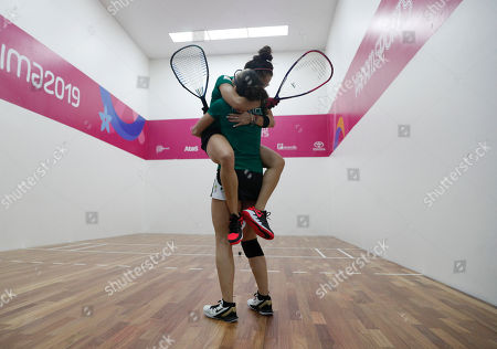 Mexico's Paola Longoria jumps into the arms of her partner Samantha Salas as they defeat Guatemala's Gabriela Martinez and Maria Rodriguez, in the women's racquetball team gold medal match at the Pan American Games in Lima, Peru